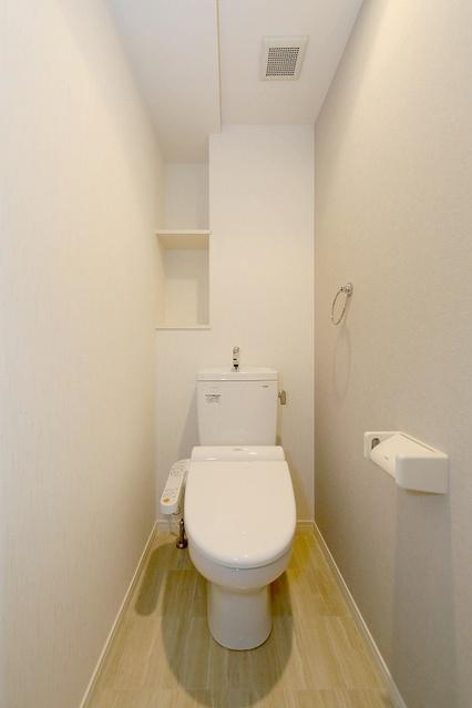 プレミールM / 101号室トイレ