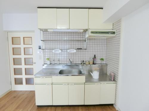 サンガーデン春日 / 305号室キッチン