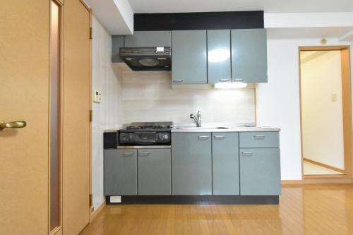 ローヤルマンション博多駅前 / 401号室キッチン